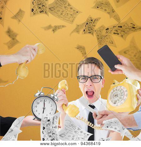 hand holding phone against orange background