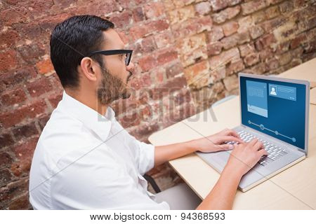 Website interface against concentrated businessman using laptop at desk