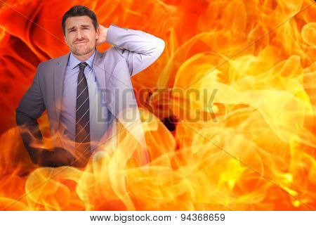 Thinking businessman against fire
