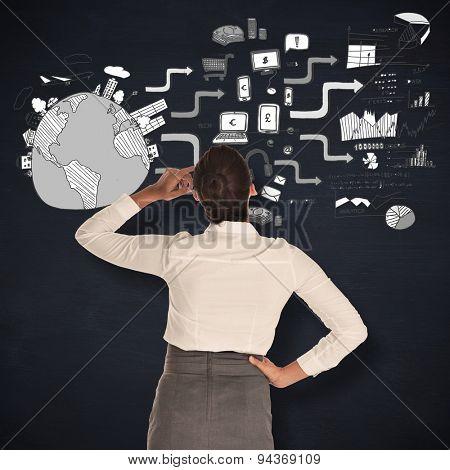 Businesswoman scratching her head against blackboard