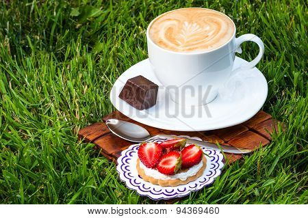 Cup Of Cappucino And Sweet Dessert
