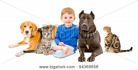 Group of pets and happy child together