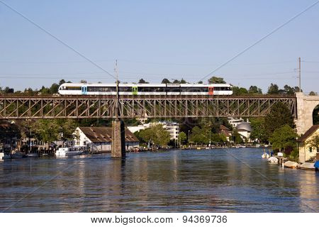 Commuter train crossing the railway on a bridge