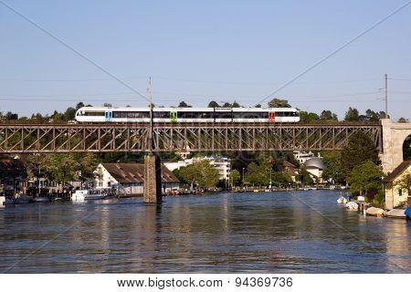 Commuter train crossing the railway on a bridge