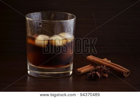 Glasses of whiskey rum with ice cubes