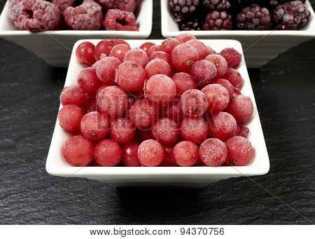 Bowls With Three Kinds Of Frozen Berries