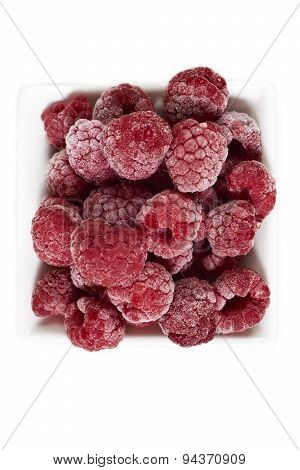 Frozen Raspberries In A White Porcelain Dish