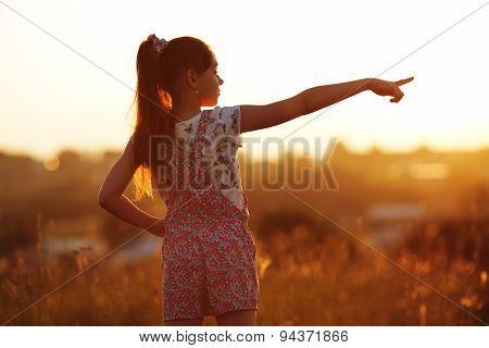 Little Girl Points Towards