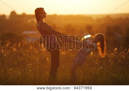 Happy Mother And Daughter In A Field