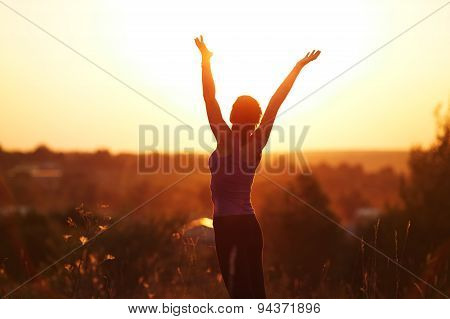 Young Woman In Evening Summer Field