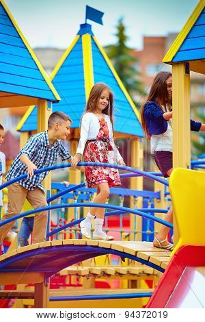 Group Of Happy Kids Having Fun On Toy Castle, On Playground