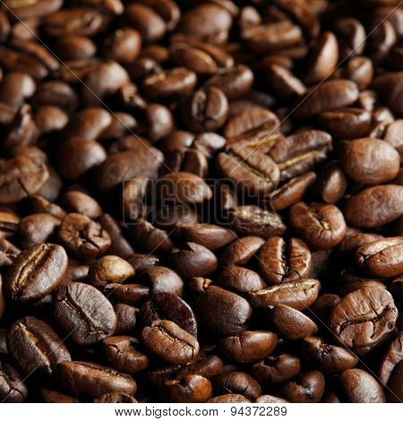 Fresh roasted coffee beans close-up background