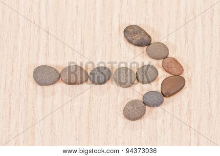 Left Arrow Lined With Sea Pebbles