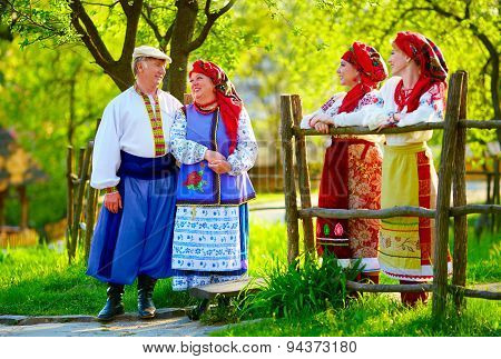 Happy Ukrainian Family, Dressed In National Costumes, Talking On The Street