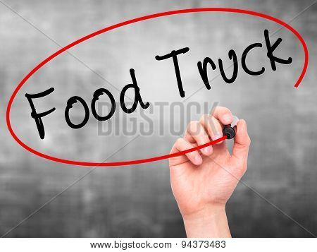 Man Hand writing Food Truck with black marker on visual screen.