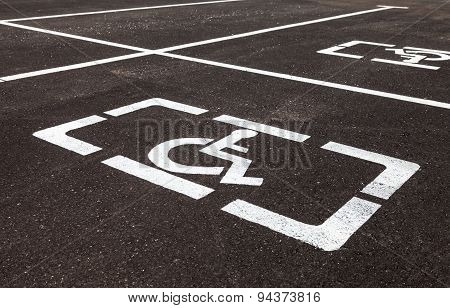 Parking Places With Handicapped Or Disabled Signs And Marking Lines On Asphalt