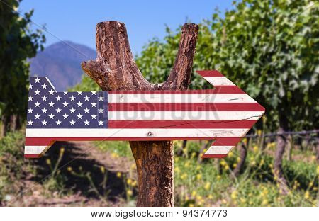 United States flag wooden sign with winery background