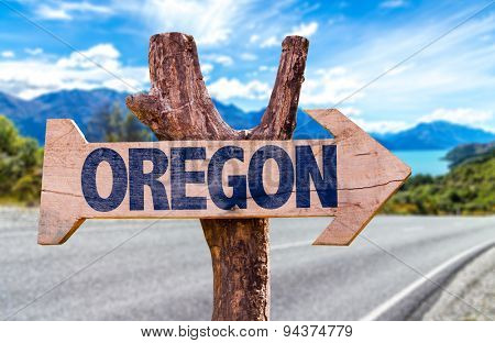 Oregon wooden sign with street background