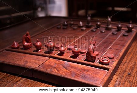 The game Ancient wooden chess standing on chessboard