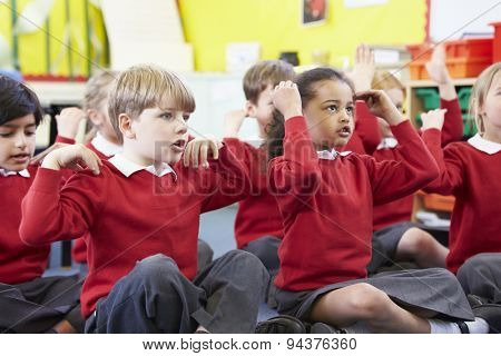 Pupils Perfoming Actions Whilst Singing Song