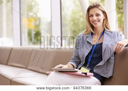 Portrait Of Female College Tutor With Digital Tablet