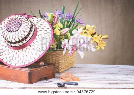 Flowers, braided hat and sewing machine