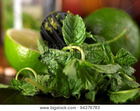 Muddler, Mint Leaves And Limes