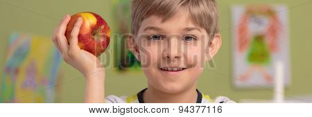 Photo Of Boy With Apple