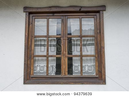 Wooden Window With White Lace Curtains