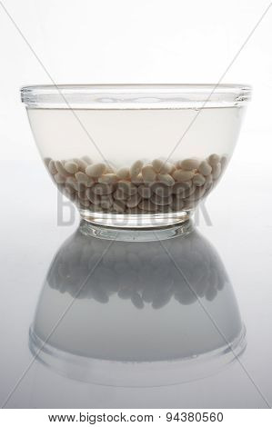 Soaked beans on white with reflection