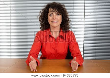 Close Up Of An Office Woman Wearing Red Blouse Working At Her Desk