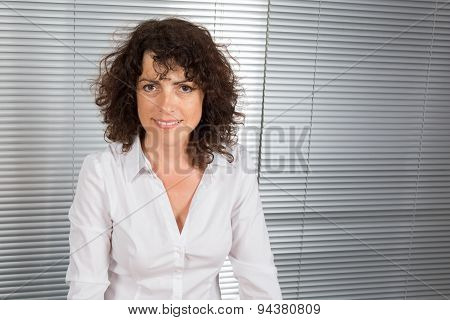 Portrait Of A Smiling Business Woman In Bright Office