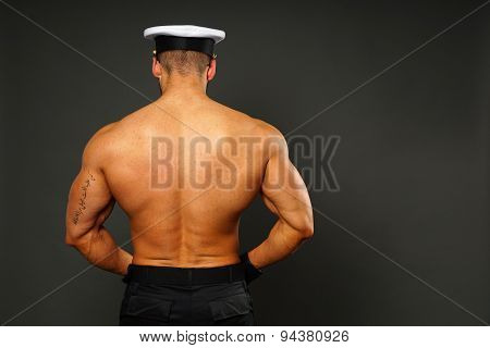 Muscular man in police cap