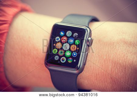 PRAGUE, CZECH REPUBLIC - June 22, 2015: Woman Using App on Apple Watch outside. Multiple Apps View.