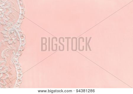 Pink Delicate satin background with lace border.