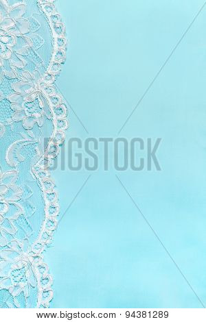 Blue Delicate satin background with lace border.