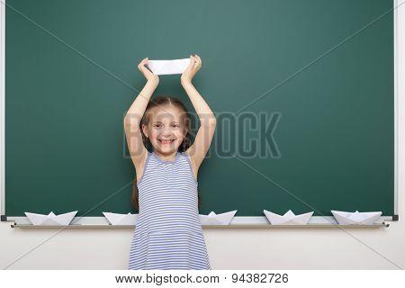 Schoolgirl near the school board
