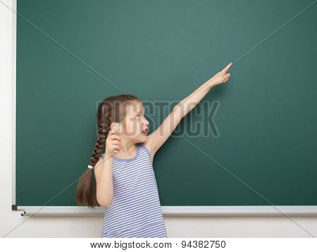 Schoolgirl near the school board