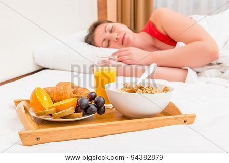 Sleeping Woman And A Tray With Breakfast