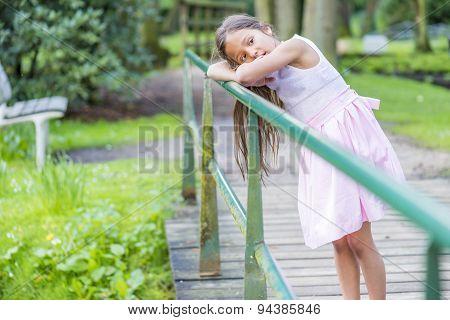 Leaning On Bridge