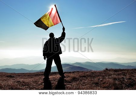 Silhouette of a man waving Argentinian flag