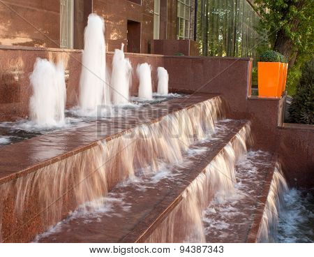 A Fountain With A Waterfall