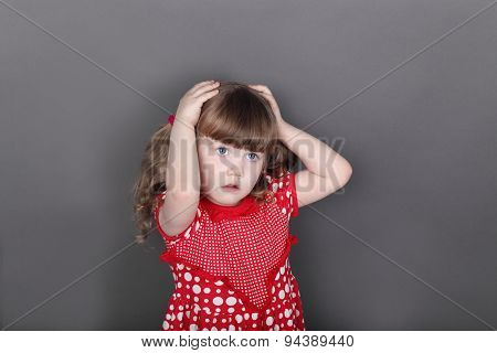 Beautiful Little Girl In Red Dress Touches Her Head In Grey Studio