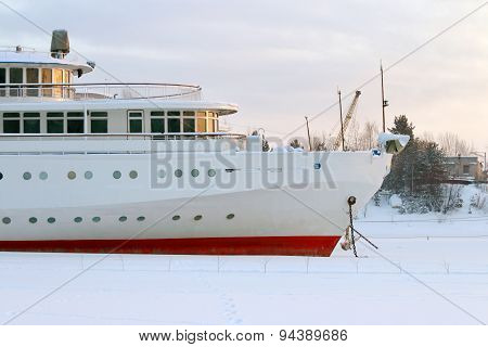 White And Red Prow Of Ship With An Anchor In Frozen River In Winter Day