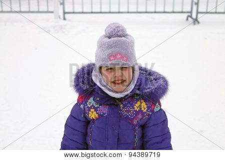 Happy Smiling Girl In Blue Jacket And Balaclava Hat Winter Day