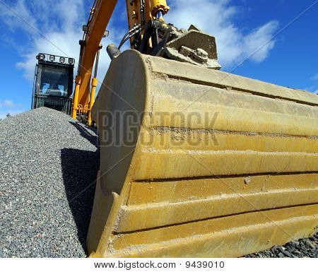 Excavator Against Blue Sky