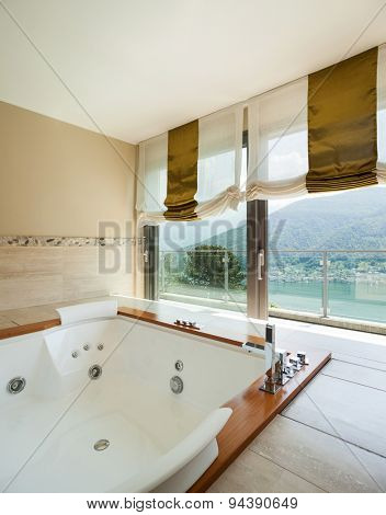 Interior of  luxury apartment, comfortable bathroom with jacuzzi