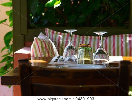 Table setting at greek cafe terrace