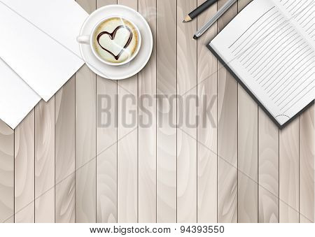 Cup of Coffee With Shape Heart And Notebook On A Wooden Desk.