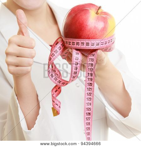 Doctor Specialist Holding Fruit Apple And Measure Tape